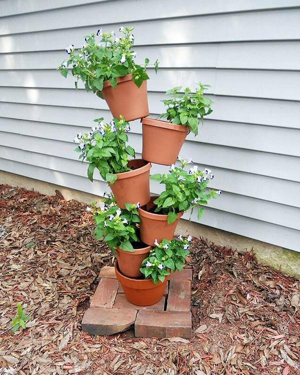 torres de vasos com flores 1